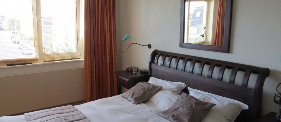 De slaapkamer na bewerking.